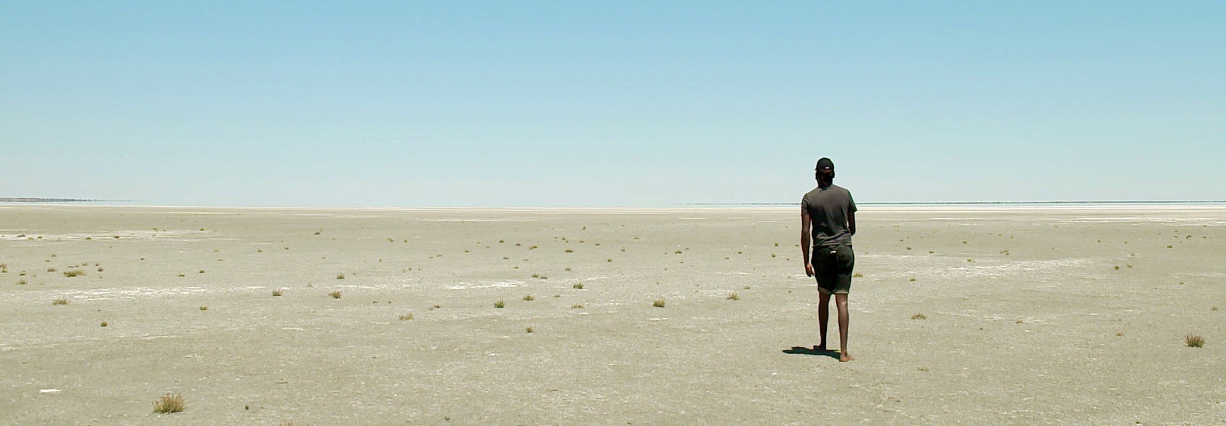 Image of man walking in remote community